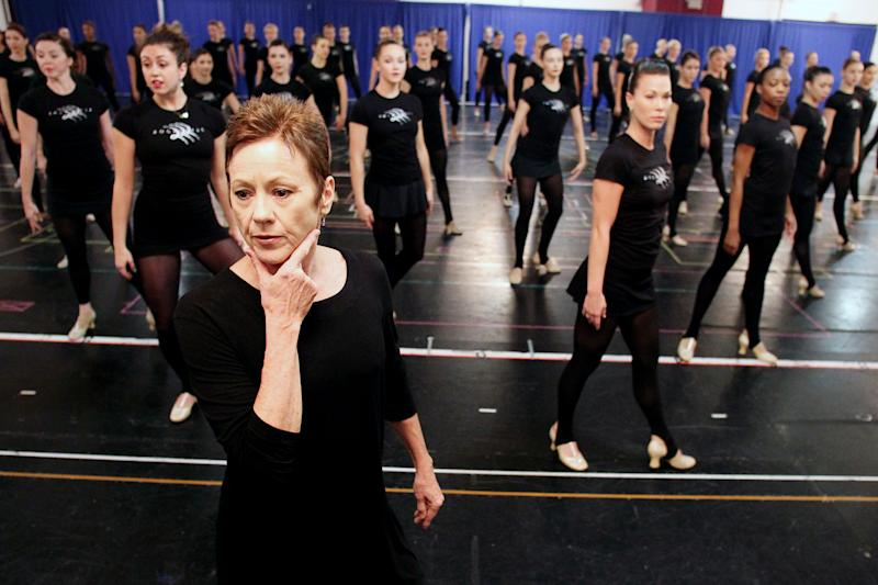 FILE - This Oct. 18, 2012 file image released by Starpix shows Rockettes director and choreographer Linda Haberman, foreground, with Rockettes dancers during rehearsals for the Radio City Christmas Spectacular at the St. Paul the Apostle Church, in New York. The Radio City Christmas Spectacular will celebrate its 85th anniversary of the Rockettes this year. The show opens Nov. 9 through Dec. 30. (AP Photo/Starpix, Dave Allocca)