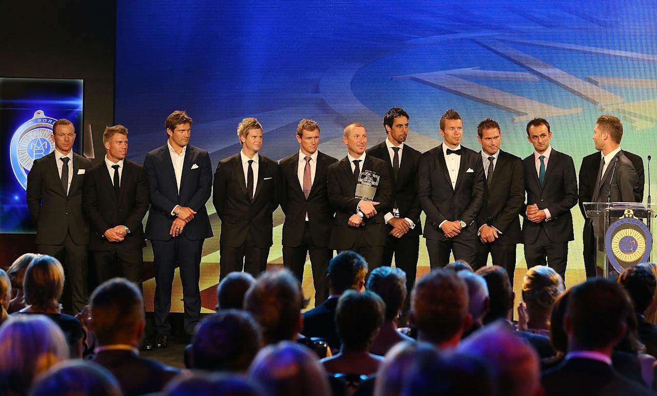 SYDNEY, AUSTRALIA - JANUARY 20:  The Australian Men's Test team pose on stage with the Ashes trophy during the 2014 Allan Border Medal at Doltone House on January 20, 2014 in Sydney, Australia.  (Photo by Mark Metcalfe/Getty Images)