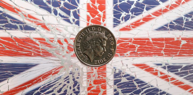 FILE PHOTO:  A pound coin is placed on broken glass and British flag in this illustration picture