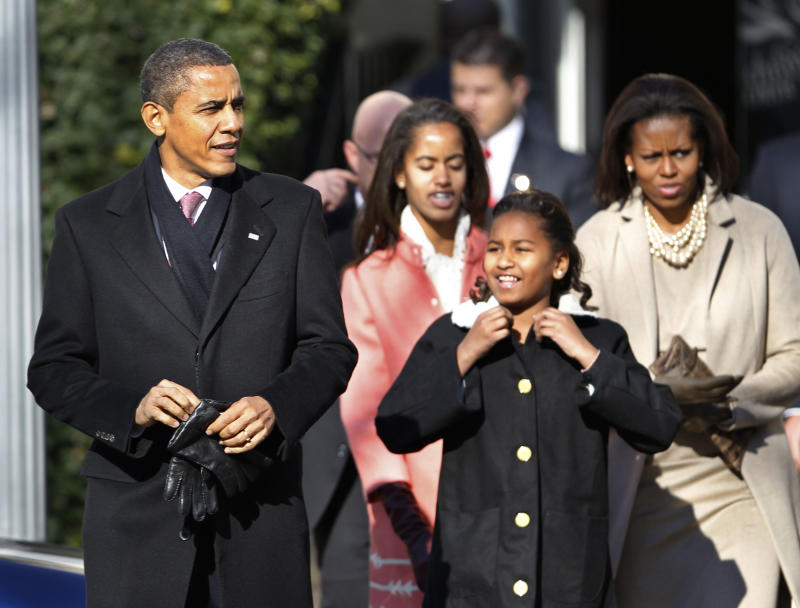 President Barack Obama, first lady Michelle Obama, and their daughters Sasha, right, and Malia leave St. John's Church in Washington after attending a Sunday church services Sunday, Dec. 11, 2011.  (AP Photo/Manuel Balce Ceneta)