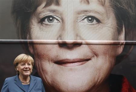 German Chancellor Angela Merkel and leader of the Christian Democratic Union party CDU stands in front of her election campaign tour bus before a CDU board meeting in Berlin September 16, 2013. REUTERS/Fabrizio Bensch