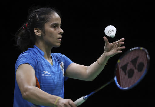 India's Saina Nehwal serves against her compatriot Venkata Pusarla during their women's singles badminton final at Carrara Sports Hall during the Commonwealth Games on the Gold Coast, Australia, Sunday, April 15, 2018. (AP Photo/Dita Alangkara)
