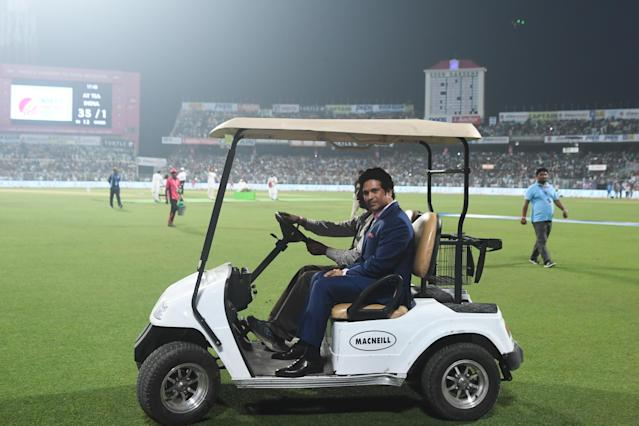 Former Indian cricketer Sachin Tendulkar rides in a golf cart during a break on the first day of the second Test cricket match of a two-match series between India and Bangladesh at The Eden Gardens cricket stadium in Kolkata on November 22, 2019. (Photo by Dibyangshu SARKAR / AFP) / IMAGE RESTRICTED TO EDITORIAL USE - STRICTLY NO COMMERCIAL USE