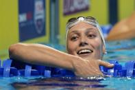 Alex Walsh reacts after winning her heat in the women's 200 individual medley during wave 2 of the U.S. Olympic Swim Trials on Tuesday, June 15, 2021, in Omaha, Neb. (AP Photo/Jeff Roberson)