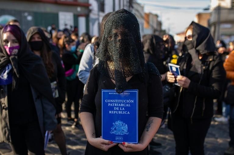 Members of the feminist collective 'Las Tesis' lead a demonstration protesting the Chile's Pinochet-era constitution, which is still in force