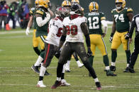 Tampa Bay Buccaneers' Jason Pierre-Paul reacts after sacking Green Bay Packers quarterback Aaron Rodgers during the first half of the NFC championship NFL football game in Green Bay, Wis., Sunday, Jan. 24, 2021. (AP Photo/Morry Gash)