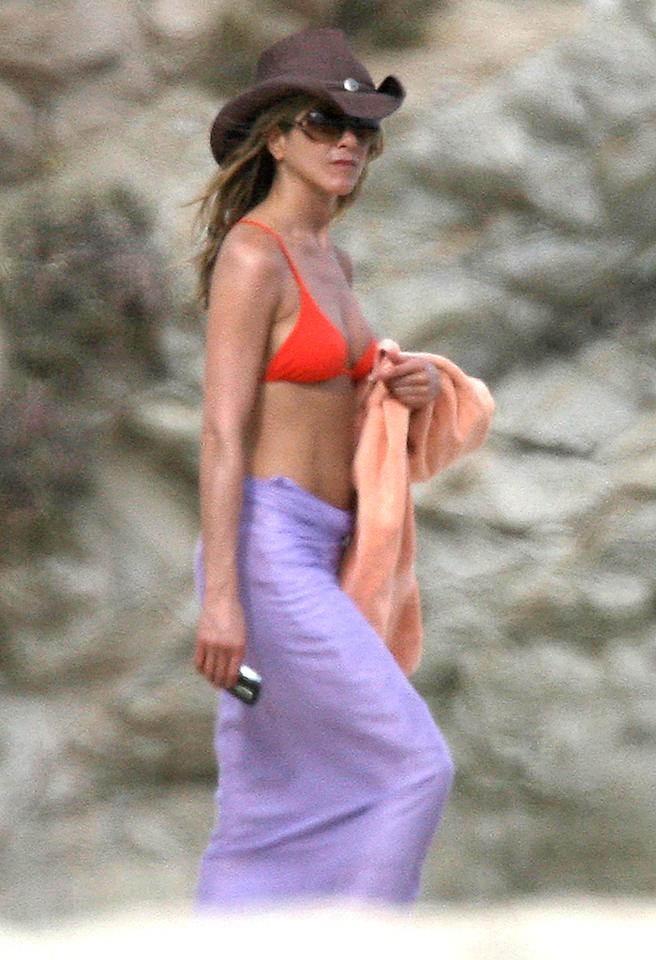 January 2, 2009: Jennifer Aniston strolls on the sand as she spends a day with pals Courteney Cox, Sheryl Crow, Laura Dern and Dern's husband Ben Harper on the beach in Cabo San Lucas. The group rented a private villa in the Mexican resort to welcome in the new year. Aniston's boyfriend John Mayer was also there for new year, but left earlier in the day on January 2nd.