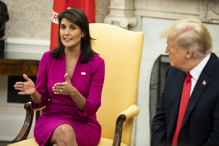 Nikki Haley, then the ambassador to the U.N., with President Donald Trump at her resignation in the Oval Office of the White House in Washington, Oct. 9, 2018. (Samuel Corum/The New York Times)