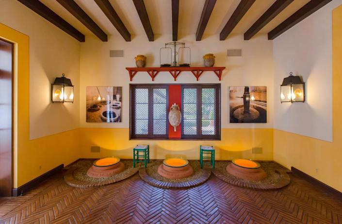 <p>This room is a tribute to the ancient olive oil industry, because Blazevich's family in Croatia is in the olive oil trade. Clay pots are embedded in the floor, historically used to hold olive oils from different varieties of trees. (Photo by Steve Brown/Sepia Productions)</p>