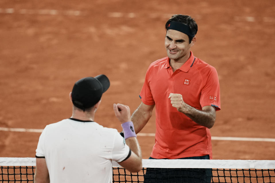 Switzerland's Roger Federer, right goes to shake hands with Germany's Dominik Koepfer, after defeating him in their third round match on day 7, of the French Open tennis tournament at Roland Garros in Paris, France, Saturday, June 5, 2021. (AP Photo/Thibault Camus)