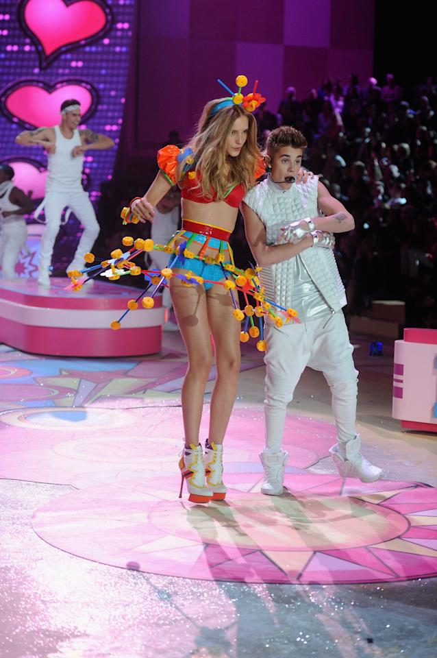 NEW YORK, NY - NOVEMBER 07:  Justin Bieber performs as model Maud Welzen walks the runway during the 2012 Victoria's Secret Fashion Show at the Lexington Avenue Armory on November 7, 2012 in New York City.  (Photo by Jamie McCarthy/Getty Images)