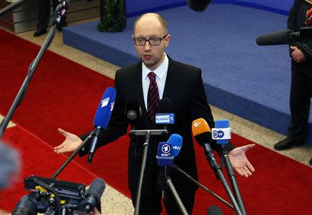 Ukraine's Prime Minister Arseniy Yatsenyuk talks to reporters while leaving a European Union leaders summit in Brussels March 21, 2014. REUTERS/Yves Herman