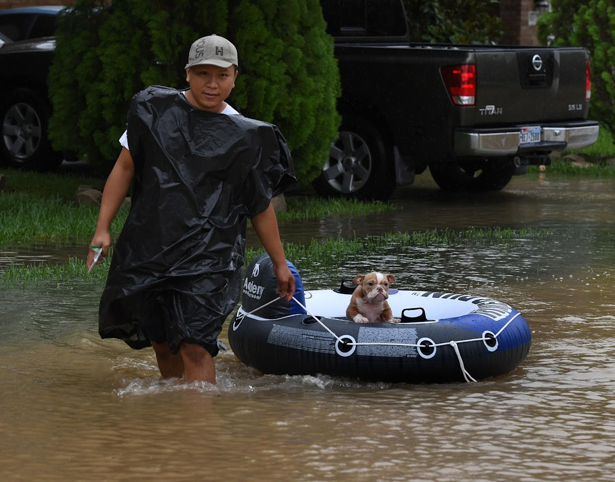 <p>John Tuan returns to rescue his dog who was left in his flooded house in the Clodine district after Hurricane Harvey caused heavy flooding in Houston, Texas on Aug. 29, 2017. (Photo: Mark Ralston/AFP/Getty Images) </p>