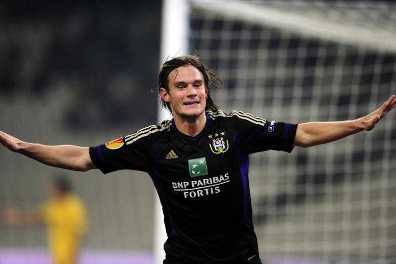 RSC Anderlecht's Guillaume Gillet celebrates after scoring against AEK Athens during their UEFA Europa league match in Athens on December 1, 2011