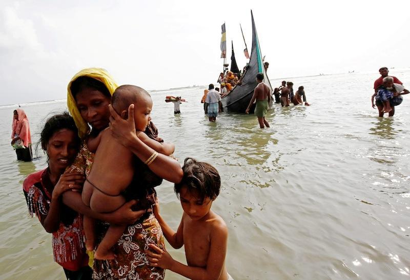 Rohingya refugee women and children walks to the shore after crossing the Bangladesh-Myanmar border by boat through the Bay of Bengal in Teknaf in this file picture taken on September 5, 2017. — Reuters pic