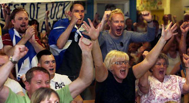 Fans react during the 1st Set while watching the Andy Murray v Novak Djokovic Wimbledon final on a screen at the Dunblane Centre in Andy Murray's home town of Dunblane in Scotland.