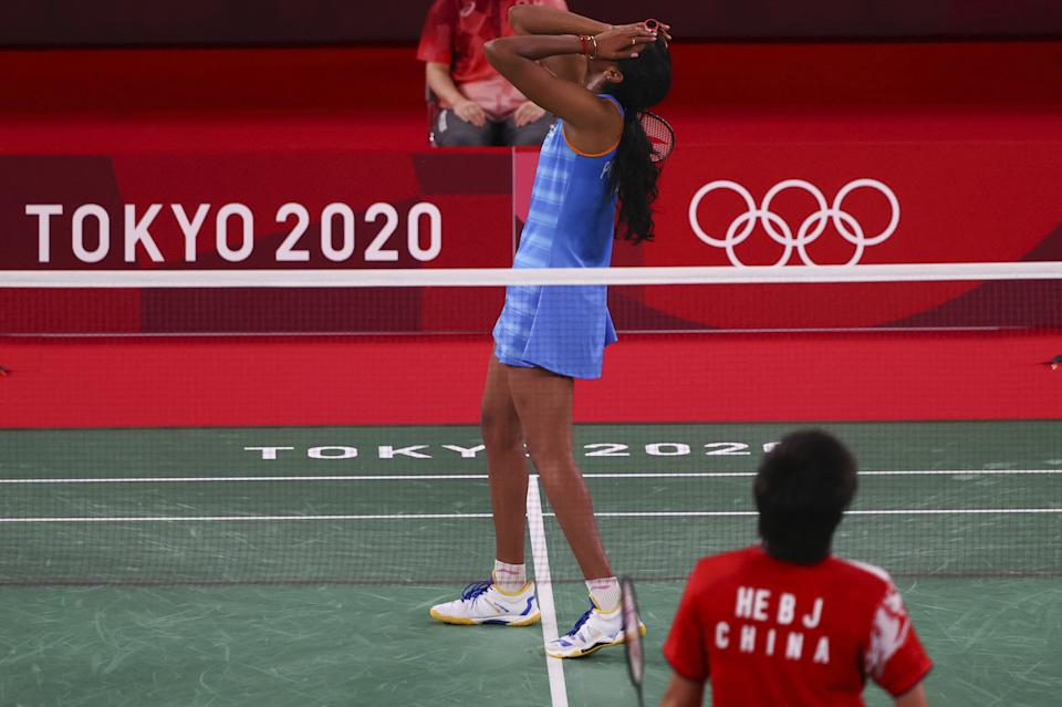 Tokyo 2020 Olympics - Badminton - Women's Singles - Bronze medal match - MFS - Musashino Forest Sport Plaza, Tokyo, Japan – August 1, 2021.  P.V. Sindhu of India reacts after winning the match against He Bingjiao of China. REUTERS/Hamad I Mohammed