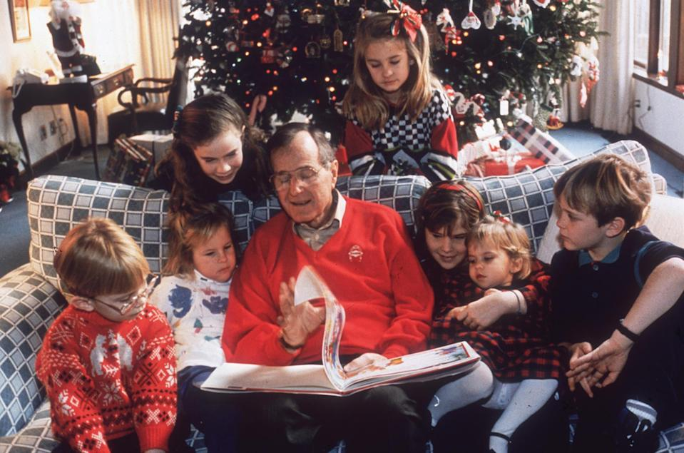 <p>President George H.W. Bush reads a Christmas story to his grandchildren on Christmas Eve in 1991.</p>