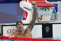 Caeleb Dressel, of United States, celebrates wining the gold medal in the men's 100-meter butterfly final at the 2020 Summer Olympics, Saturday, July 31, 2021, in Tokyo, Japan. (AP Photo/Jae C. Hong)