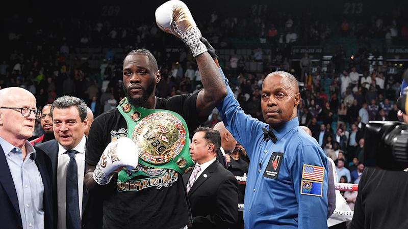 Pictured here, Deontay Wilder celebrates his heavyweight title defence against Luis Ortiz.