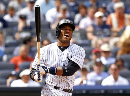FILE PHOTO: New York Yankees Robinson Cano reacts to a strike call against the Tampa Bay Rays during the seventh inning of their MLB American League baseball game at Yankee Stadium in New York, July 27, 2013. REUTERS/Adam Hunger