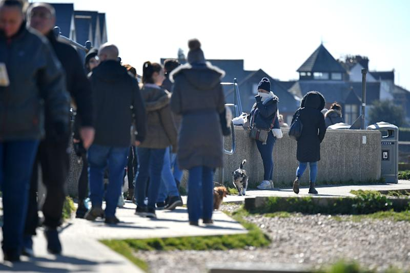 People enjoy the sunshine on the seafront at Whitstable at the weekend (AFP via Getty Images)