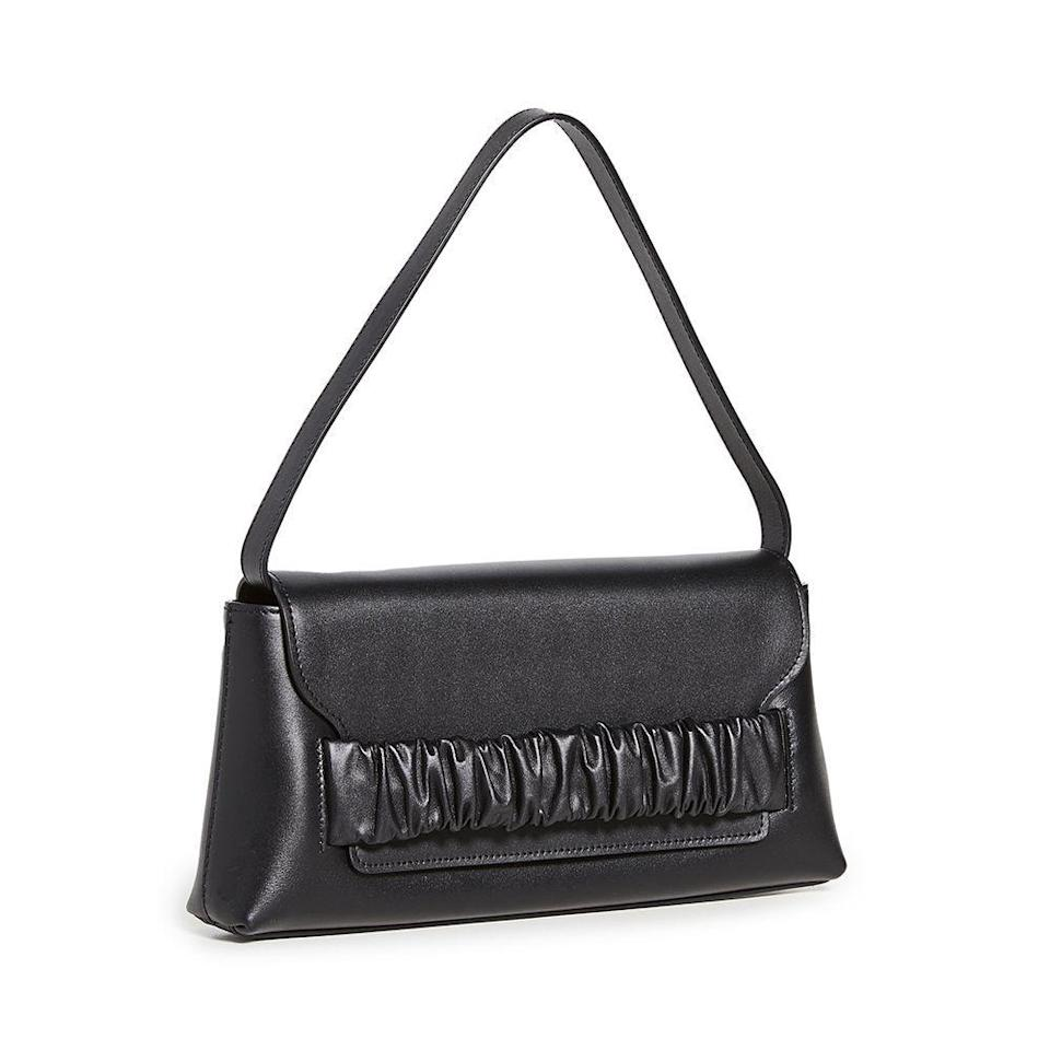 """<p><strong>Elleme </strong></p><p>shopbop.com</p><p><a href=""""https://go.redirectingat.com?id=74968X1596630&url=https%3A%2F%2Fwww.shopbop.com%2Fchouchou-baguette-elleme%2Fvp%2Fv%3D1%2F1587539355.htm&sref=https%3A%2F%2Fwww.townandcountrymag.com%2Fstyle%2Ffashion-trends%2Fg36107567%2Fshopbop-spring-sale%2F"""" rel=""""nofollow noopener"""" target=""""_blank"""" data-ylk=""""slk:Shop Now"""" class=""""link rapid-noclick-resp"""">Shop Now</a></p><p><strong><del>$515</del> $412 (20% off)</strong></p><p>Editor's note: I've been eyeing this shoulder bag from Elleme for weeks. Glamorous enough to wear to friends' weddings but suave enough for art galleries and date nights, this is the item I'm most tempted to splurge on from the sale. </p>"""