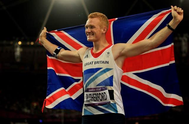 Greg Rutherford celebrates his gold medal at London 2012 (Stephen Pond/PA)