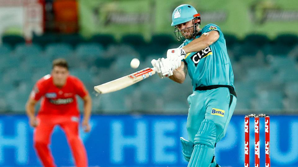 Pictured here, Chris Lynn blasts a ball from the Renegades towards the boundary.