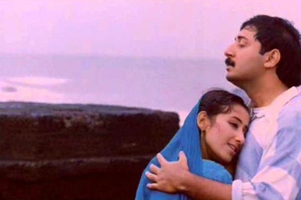 Though not Mani Ratnam's best, owing to the sensitivity of the subject it presents and builds upon, this 90's release had a huge appeal among the cine-goers. <em>Bombay</em>, despite being made with communal riots as its focal point, has an innocence about it; the music, the acting, and the execution of the story exude peace. We doubt if any other maker will be able to recreate this environment without drawing unnecessary political attention and causing flare ups.