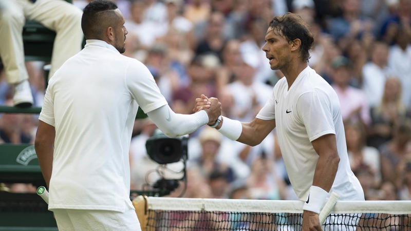 Rafael Nadal and Nick Kyrgios shake hands after their match at Wimbledon. (Photo by Visionhaus/Getty Images)