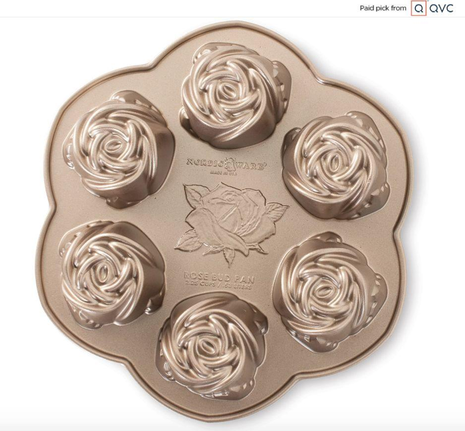 """Your friend won't need rose-colored glasses to appreciate thisrosebud cake pan. It's too cute, with six spaces to fill for mini cakes and muffins.<a href=""""qvc.uikc.net/Lj4O0"""" target=""""_blank"""" rel=""""noopener noreferrer"""">Find it for $34 at QVC</a>."""