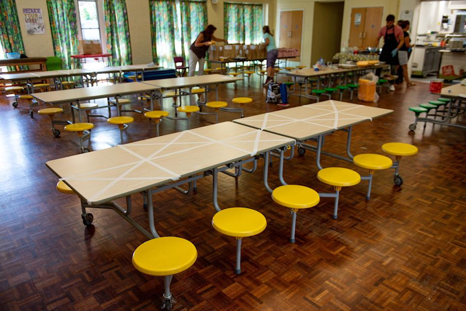 Tables are marked showing where children can sit during dinner time at Kempsey Primary School in Worcester. Nursery and primary pupils could return to classes from June 1 following the announcement of plans for a phased reopening of schools. (Photo by Jacob King/PA Images via Getty Images)