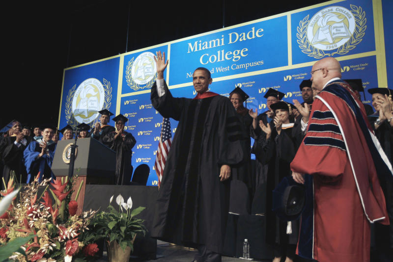 President Barack Obama takes the stage at the Miami Dade College North and West Campus graduation, Friday, April 29, 2011, at the James L. Knight International Center in Miami. (AP Photo/Charles Dharapak)