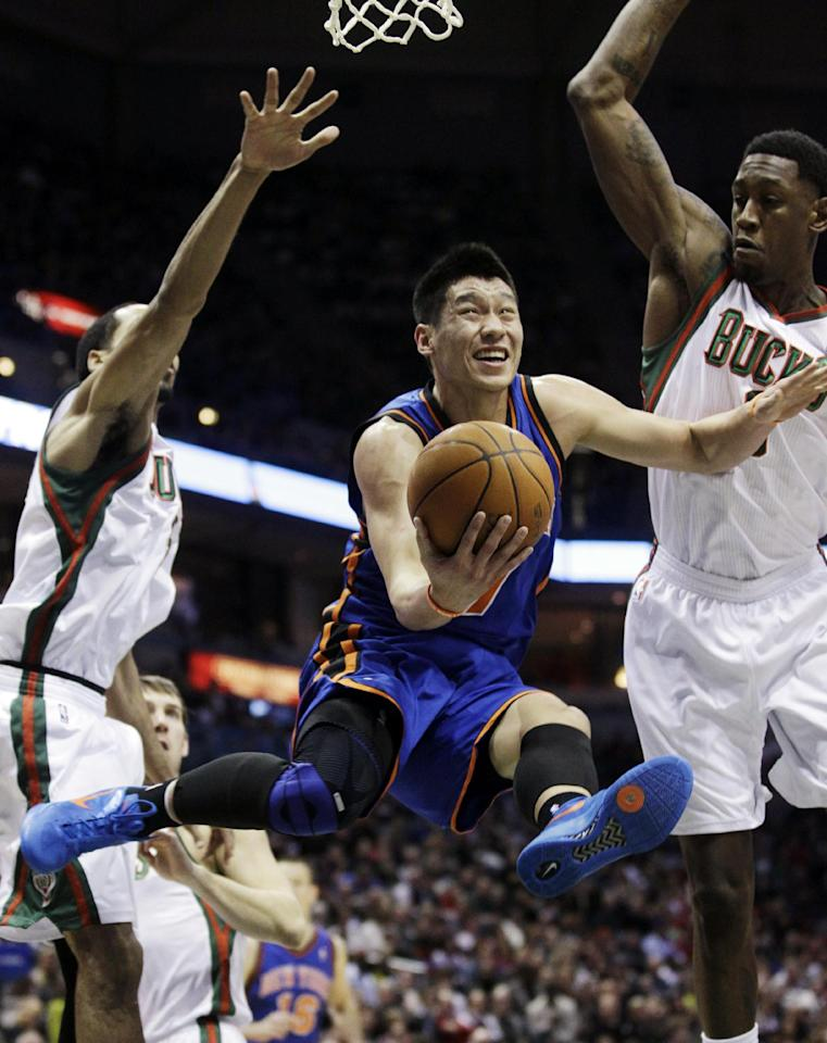 FILE - This March 9, 2012 file photo shows New York Knicks' Jeremy Lin shooting between Milwaukee Bucks' Shaun Livingston, left, and Larry Sanders during the first half of an NBA basketball game in Milwaukee. This would have been such an easy decision in February. Lin was the biggest thing in basketball, and no way the Knicks would have let him go elsewhere. Now, knowing his price and with no assurance he'll play as he did when Linsanity reigned, the Knicks may allow Lin to leave for Houston.(AP Photo/Morry Gash, File)