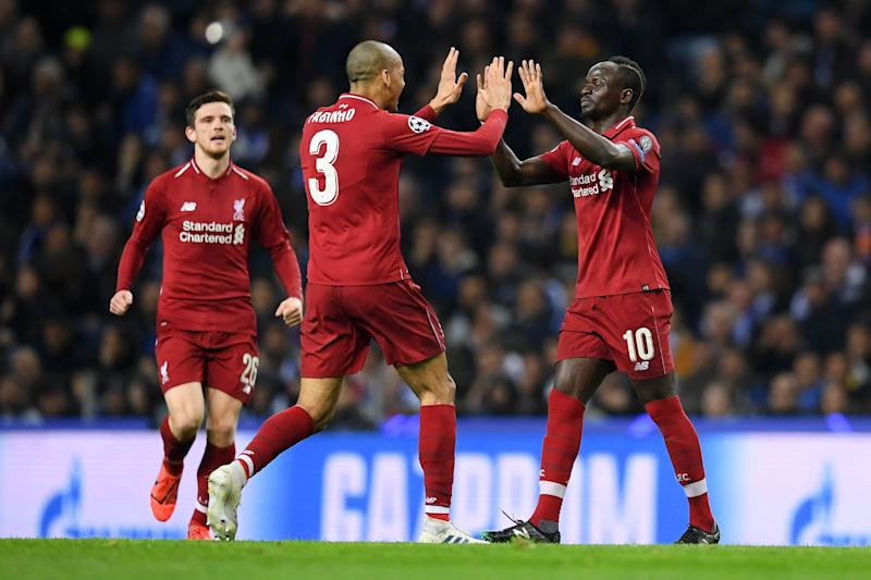 Sadio Mane of Liverpool celebrates with teammate Fabinho of Liverpool after scoring his team's first goal during the UEFA Champions League Quarter Final second leg match