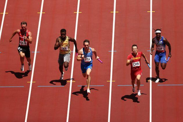 TOKYO, JAPAN - AUGUST 05: (L-R) Frederik Schou-Nielsen of Team Denmark, Lucas Ansah-Peprah of Team Germany, Filippo Tortu of Team Italy, Zhiqiang Wu of Team China and Cravon Gillespie of Team United States compete in round one of the Men's 4x100m Relay heats on day thirteen of the Tokyo 2020 Olympic Games at Olympic Stadium on August 05, 2021 in Tokyo, Japan. (Photo by Ryan Pierse/Getty Images) (Photo: Ryan Pierse via Getty Images)
