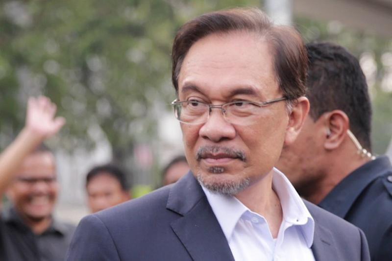 Anwar walks out of hospital a free man