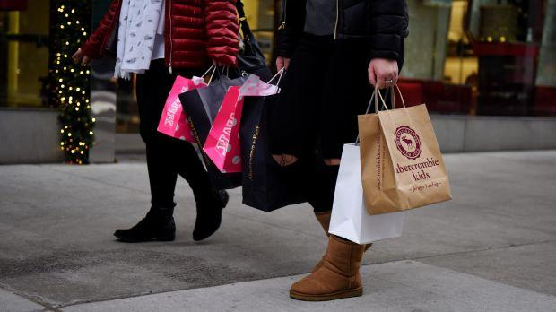 Shoppers carry bags from a number of stores including Abercrombie & Fitch and Victoria's Secret along Fifth Avenue in the Manhattan borough of New York