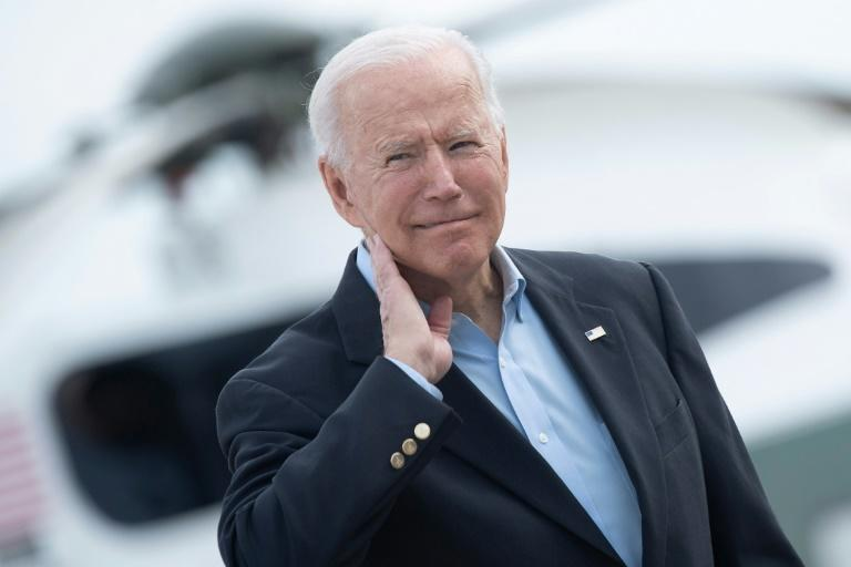 President Joe Biden touches his neck after a cicada crawled up it on June 9, 2021