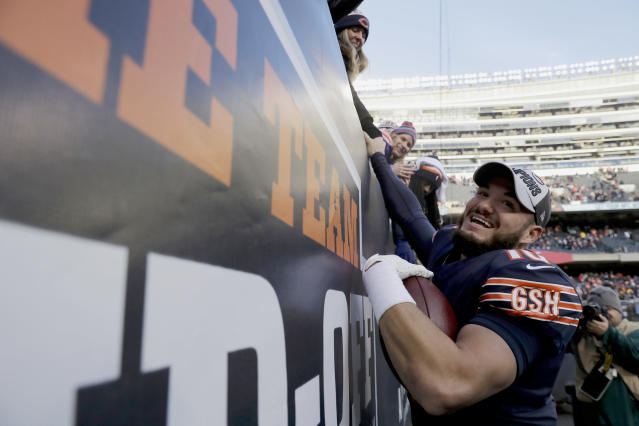 Everybody celebrate: Chicago Bears quarterback Mitchell Trubisky greets fans after the team's playoff-clinching win on Sunday. (AP)