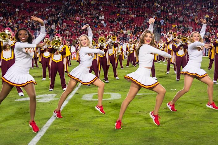 USC song girls Josie Bullen (far right) and Adrianna Robakowski (second from right) perform during a Trojans football game.