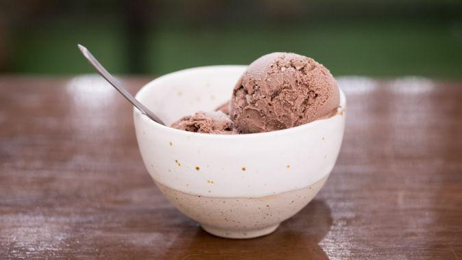 Homemade chocolate Ice cream scoop served on cup.