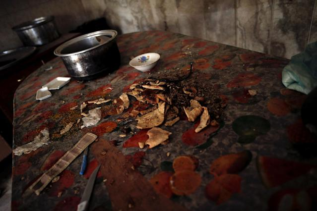<p>Rotten food is seen on a kitchen table inside a compound used as a prison by Islamic State militants in the 17 Tamuz (July 17) district, in western Mosul, Iraq, June 6, 2017. (Alkis Konstantinidis/Reuters) </p>