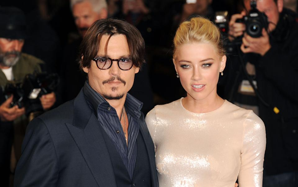 LONDON, UNITED KINGDOM - NOVEMBER 03: Johnny Depp and Amber Heard attend The UK Premiere of 'The Rum Diary' at  on November 3, 2011 in London, England. (Photo by Stuart Wilson/Getty Images)