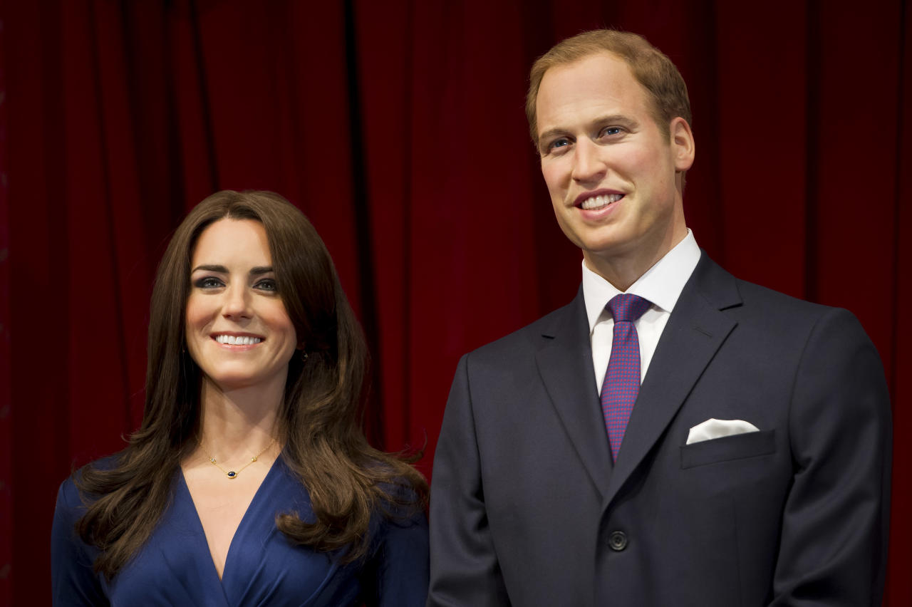 Waxworks of the Duke and Duchess of Cambridge are unveiled at Madame Tussauds, London, Wednesday, April 4, 2012. (AP Photo/Jonathan Short)