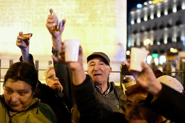 There were joyful scenes in Madrid after Franco's remains were moved (AFP Photo/OSCAR DEL POZO)