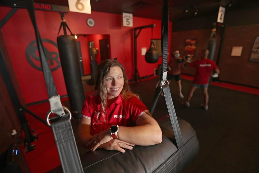 LONG BEACH, CA - JUNE 30:. Ashley Richardson, franchise owner of 9Round Fitness gym in Long Beach, said that it's hard for her business to find personal trainers to hire in the coronavirus postpandemic reopening. (Luis Sinco / Los Angeles Times)