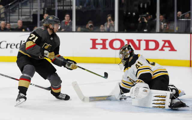 Boston Bruins goaltender Jaroslav Halak (41) blocks a shot by Vegas Golden Knights center William Karlsson (71) during the second period of an NHL hockey game Wednesday, Feb. 20, 2019, in Las Vegas. (AP Photo/John Locher)
