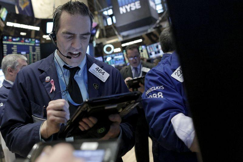 Trader Greg Rowe asks for a price at the Barclay's post on the floor of the New York Stock Exchange